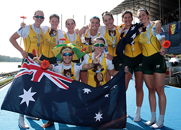 Women's eight celebrate their medal